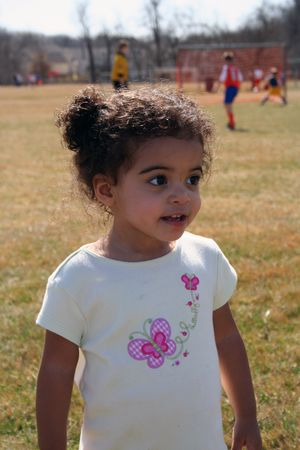 two year old: Two year old girl outside at a soccer game. Stock Photo