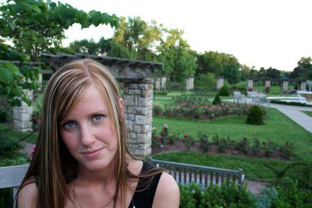 Woman posing in a garden photo