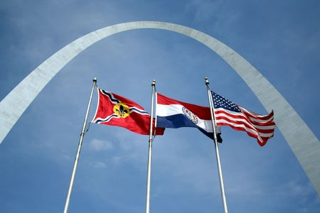 The Arch in St Louis with three flags