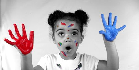 Cute toddler girl with paint on both of her hands