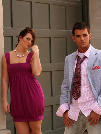 Classy woman and man posing in front of building Stock Photo - 3347413