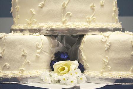 Pretty cream colored three tier wedding cake