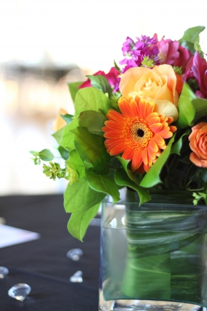 vase: A beautiful arrangement of flowers on table at reception