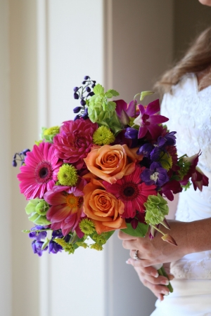 A bride holding a bright bouquet of flowers