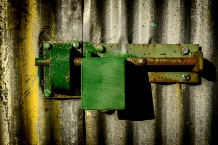 Close-up padlock on rusty door photo