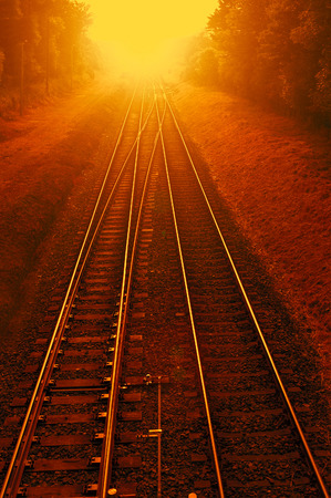 photomanipulation: Photomanipulation of railways with a distant explosion.