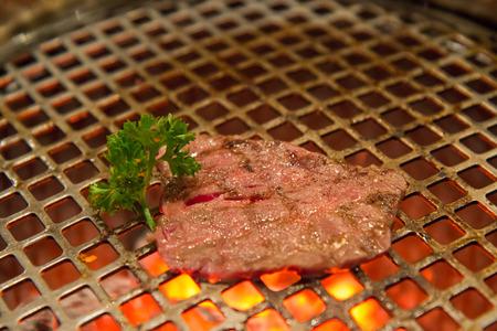 medium rare beef grill on metal mesh in japan restaurant, Yakiniku Stock Photo