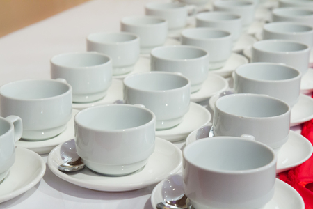 coffee or tea cups in row on table