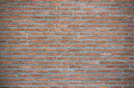 unfinished red brick wall with dark vignette Stock Photo