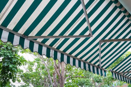 green and white stripe awning, automatic mechanic awning Standard-Bild