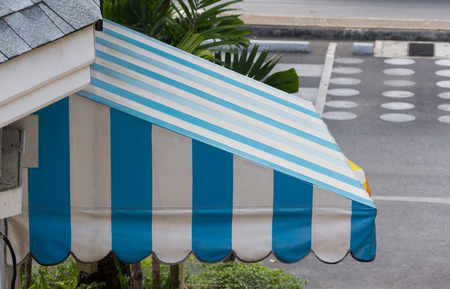 blue and white awning decor in front of the shop