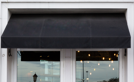 Black awning over cafe windows