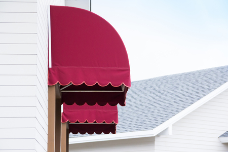 red canvas awnings of house