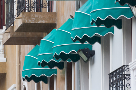 wet green awning with raining