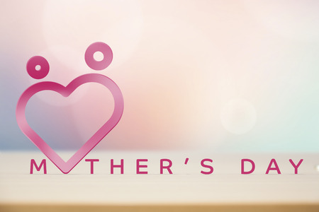 Happy  Mothers day with shape of heart on pink background.  Stock Photo