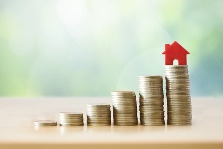 Saving money for real estate with buying a new home and loan for prepare in the future mortgage and real estate investment .Investment and saving concept.
