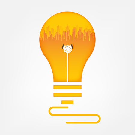 Handshake and city in light bulb. Business handshake cooperate concept.vector art and illustration.
