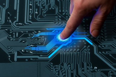 technologia: power mans finger is charging passive circuit board with blue energy