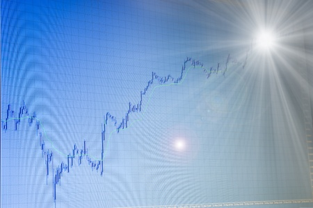 backgroud: blue growing forex stock chart on blue backgroud on monitor of terminal is going to bright light in the end Stock Photo