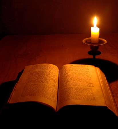 holy bible: antique bible on jewish with candle on wooden table