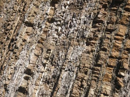braunen Stein Felsen Oberfläche mit diagonalen Linien Lizenzfreie Bilder