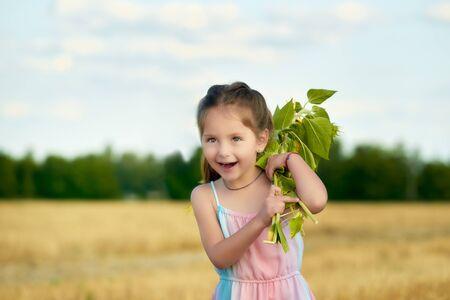 Portrait of a cheerful little cute little girl