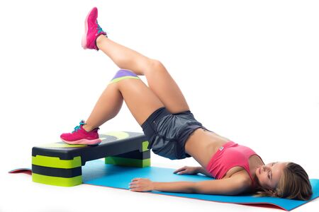 Woman doing exercises for legs lying on the mat Stock fotó
