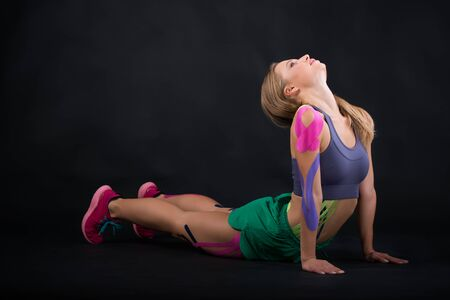 Kinesio tape girl, exercise push ups Stock Photo