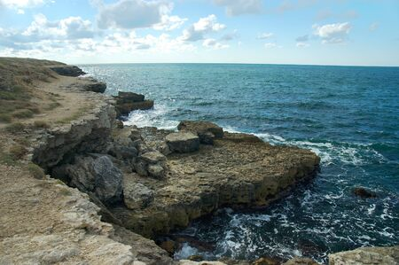 Crimea deserted rocky coast washed by the waters of the Black Sea. Natural stocks of lamb.