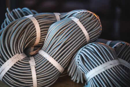Close-up of a huge bundle of metal flexible tubes interconnected in a factory or industry plant. The concept of modern mining or IT of high-tech industries