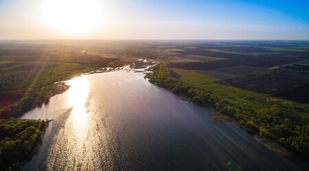 Sunrise over a beautiful river from a birds eye view