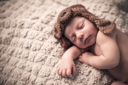 Cute little newborn baby in a knitted suit lies
