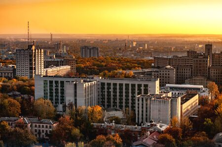 Aerial view of a city with high-rise buildings streets and construction sites on a sunny autumn day. The concept of a developing modern European city