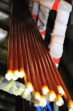Close-up of a conductors of red copper wire in the kapton insulation. Concept of electrical appliances and repair.