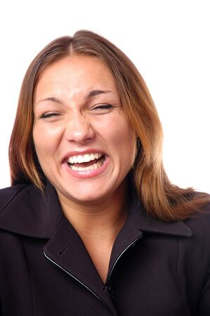 Headshot of happy emotional teenage girl laughing from the bottom of her heart, keeping eyes closed, perfect white teeth