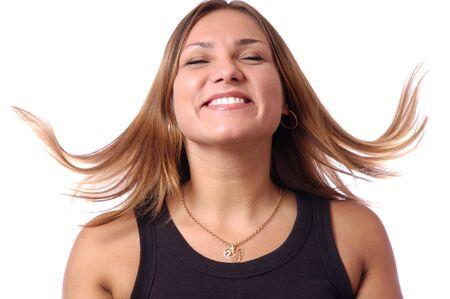 Headshot of happy emotional teenage girl laughing, hair dancing, keeping eyes closed, perfect white teeth