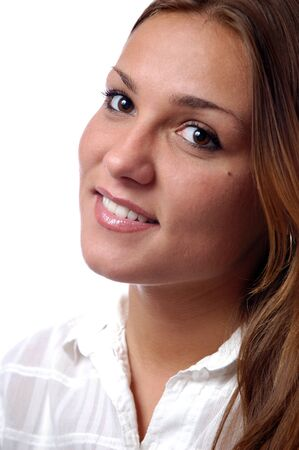 Close-up portrait of a young magnificent girl with natural make-up, brown long hair, white plain shirt