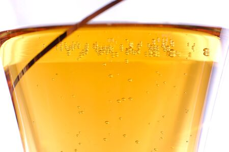 Wineglass with white wine, close-up transparent champagne