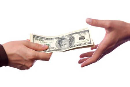 Hand giving money to another hand isolated, bribes and corruption