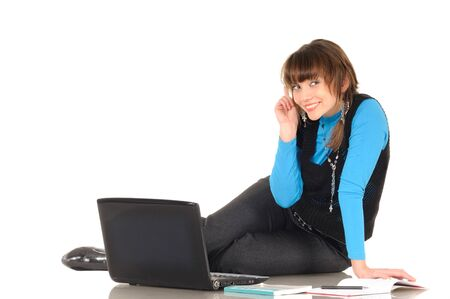 Young woman in student role posing with modern laptop on white background Stock Photo