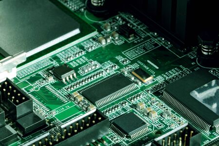 Close-up board with micro chips from an electrical appliance or computer. Concept of modern technology. Concept of electronics and microchips Stock fotó