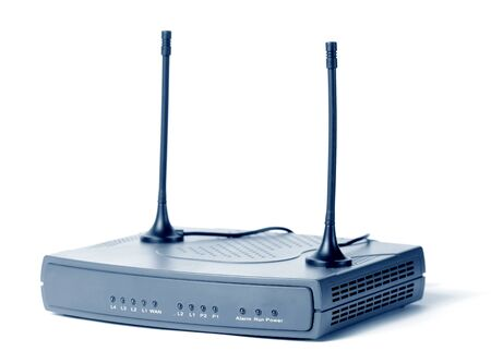 Close-up of an Internet modem and TV receiver of television channels with an antenna stands on a white table on a white background. Concept device for accessing the Internet. Advertising space