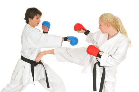 Young karate trainer and student in combat gloves and kimono and trains getting ready for the studio championship on a white background. Martial arts concept. Advertising space