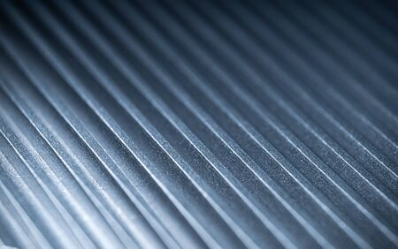 Close-up of a fluted metal surface on an unidentified automatic control device at an automobile factory. The concept of secret engineering. Place for text Фото со стока