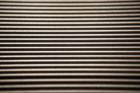Close-up of a corrugated metal surface of an unidentified factory equipment. The concept of sophisticated equipment and modern technology. The concept of the production of military devices Stock Photo