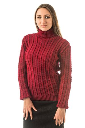 Portrait of a beautiful young slim girl in a red knitted sweater posing on a white background in the studio. Concept of strong warm knitwear. Advertising space Banque d'images - 135495182