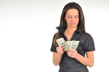 Beautiful woman holds dollar bills in her hands, full length photo, isolated on white background