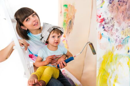 Woman and small child sitting on stepladder