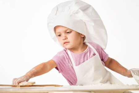 Portrait of a cute little child in a chefs hat Stock Photo