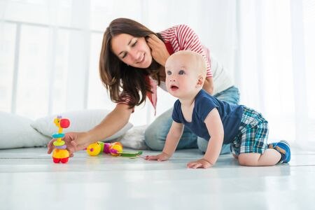 Charming cute cheerful boy with a happy caring mom Stockfoto